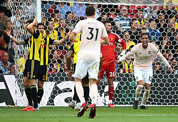 Manchester United's Chris Smalling (right) celebrates scoring his side's second goal of the game during the Premier League match at Vicarage Road, Watford