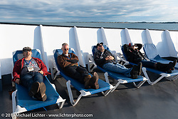 Richard Campbell (L>R), Bryan Bossier Sr,  Matt Miller and Cris Sommer-Simmons relaxing on the forward deck of the SS Badger ferryboat as we crossed Lake Michigan during the Cross Country Chase motorcycle endurance run from Sault Sainte Marie, MI to Key West, FL (for vintage bikes from 1930-1948). Stage 2 from Ludington, MI to Milwaukee, WI, USA. Saturday, September 7, 2019. Photography ©2019 Michael Lichter.