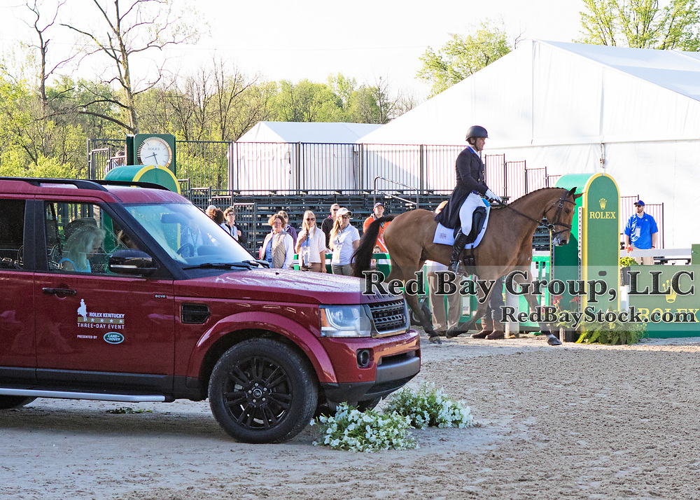 Phillip Dutton (USA) rides Fernhill Fugitive with a Land Rover 2016 LR4 on display in the background at the 2016 Rolex Kentucky Three-Day Event, Presented by Land  Rover.<br />