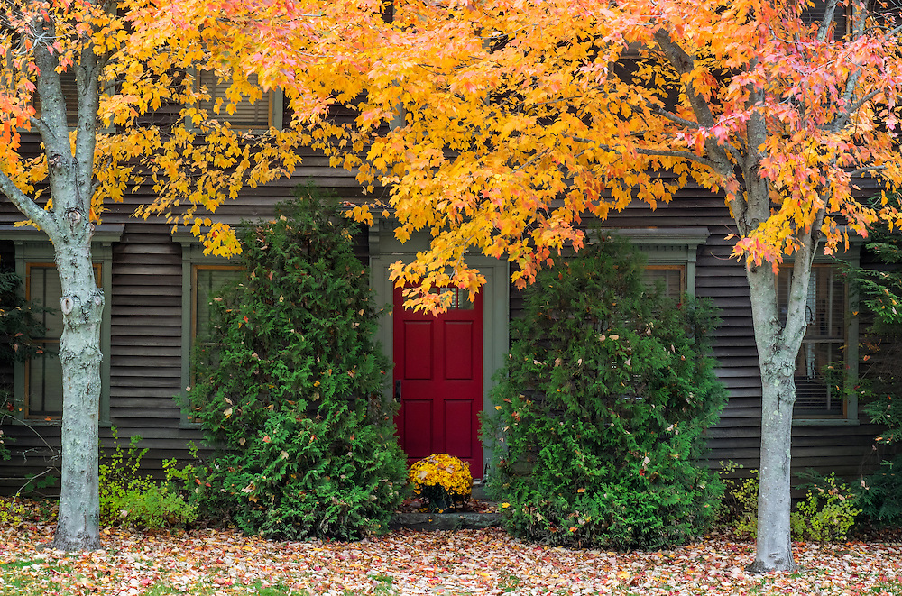 Rockport Maine in autumn, a very colorful mix of colors, the red door anchors the composition.