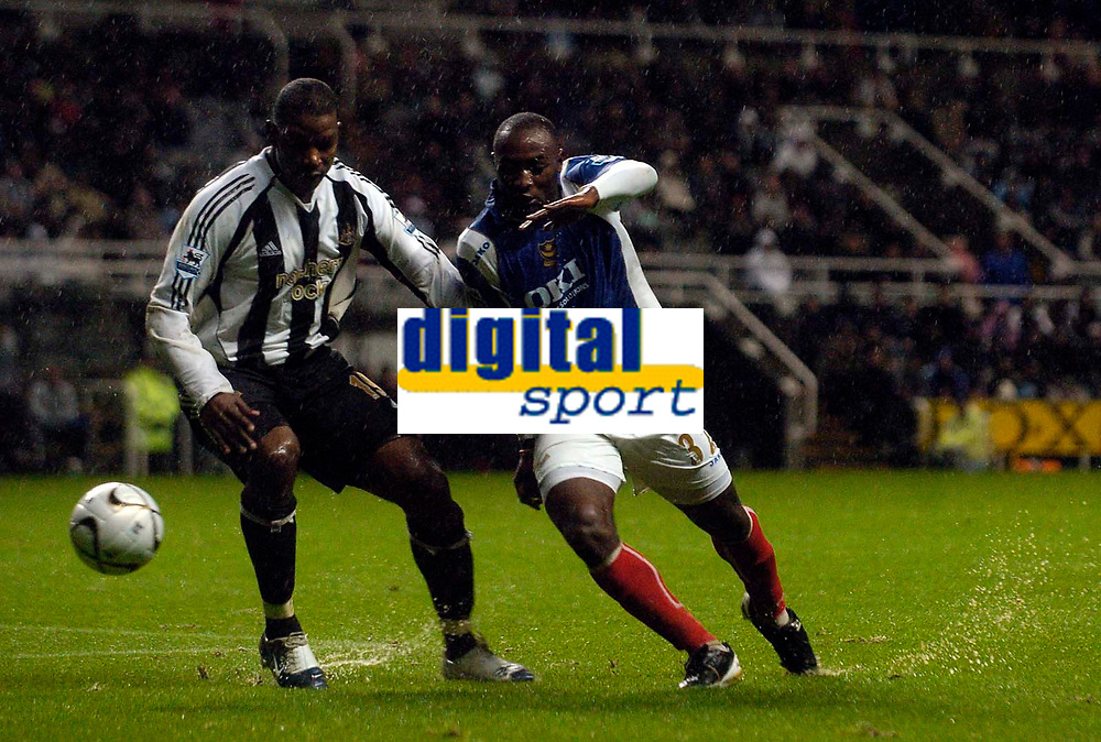 Photo: Jed Wee.<br /> Newcastle United v Portsmouth. Carling Cup. 25/10/2006.<br /> <br /> Portsmouth's Lomana Lua Lua (R) tries to get past Newcastle's Titus Bramble.