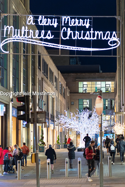 Edinburgh, Scotland, UK. 14 December 2020. City of Edinburgh controversially remains in Level 3 of lockdown meaning bars and restaurants must close at 6pm and not sell alcohol. Most bars have chosen to remain closed, Tuesday will see Scottish Government announce if the city will relax lockdown to level 2 or remain at level 3. Pic; Night view of upmarket Multrees Walk shopping arcade.  Iain Masterton/Alamy Live News