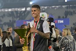 May 19, 2019 - Turin, Turin, Italy - Jo‹o Cancelo  of Juventus FC lints the trophy of Scudetto  2018-2019 at Allianz Stadium, Turin  (Credit Image: © Antonio Polia/Pacific Press via ZUMA Wire)