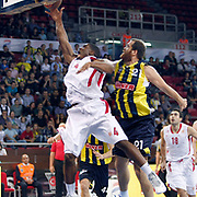 Fenerbahce Ulker's Oguz SAVAS (R) and Olimpiakos's Kyle HINES (L) during their Two Nations Cup basketball match Fenerbahce Ulker between Olimpiakos at Abdi Ipekci Arena in Istanbul Turkey on Saturday 01 October 2011. Photo by TURKPIX