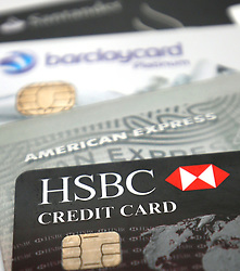 File photo dated 06/01/15 of credit cards as a quarter of holidaymakers who rely on their credit or debit cards while travelling abroad have had their plastic blocked during their trip, research has found.