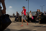 Evening rush-hour commuters walk homewards through the anti-terrorism security barriers on London Bridge, on 20th April 2018, in London, England.
