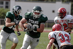 09 September 2006 Titan tight end Brock Klein takes it to Comet Michael Terranova..In the first ever football competition between the Olivet Comets and the Illinois Wesleyan Titans, the Titans strut off the field with a 21- 6 victory. .Game action took place at Wilder Field on the campus of Illinois Wesleyan University in Bloomington Illinois.