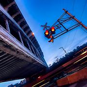 The train crossing underneath the 12th Street Bridge in the West Bottoms area of Kansas City, Missouri, sunrise, October 2010.