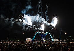 © Licensed to London News Pictures. 27/06/2015. Pilton, UK.  The Arcadia Spectacular at Glastonbury Festival 2015 on the evening of Saturday Day 4 of the festival - this is the Arcadia spectacular, a dance music zone featuring Arcadia fuse recycled military hardware as a sculpted giant spider, flaming explosions, and performance.  This years headline acts include Kanye West, The Who and Florence and the Machine, the latter being upgraded in the bill to replace original headline act Foo Fighters. Photo credit: Richard Isaac/LNP