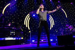 "© Licensed to London News Pictures. 26/01/2013. London, UK.   Ronan Keating performing live at The O2 Arena to promote his ninth studio album ""Fires"". During the encore of the gig, Ronan is joined onstage by fellow Boyzone bandmate Shane Lynch, when they announce plans for Boyzone to tour the UK later in the year.  Ronan Keating is an Irish recording artist, singer-songwriter, musician, and philanthropist.  His solo career started in 1999.  Keating debuted on the professional music scene alongside Keith Duffy, Mikey Graham, Shane Lynch and Stephen Gately, in 1994 as the lead singer of Irish group Boyzone.  Photo credit : Richard Isaac/LNP"