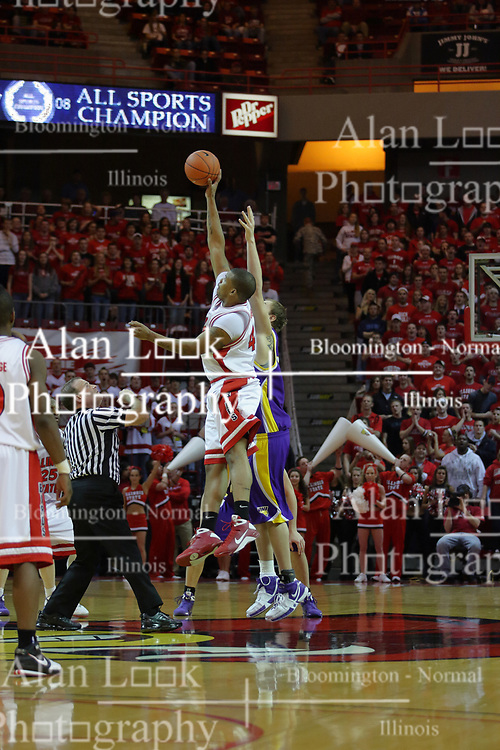 24 February 2009:  Referee Gerry Pollard tosses up the tip off with Brandon Sampay getting the tip for the 'Birds. The Redbirds of Illinois State University lost the Panthers of Northern Iowa in double overtime by a score of 69-67 on Doug Collins Court inside Redbird Arena on the campus of Illinois State University in Normal Illinois