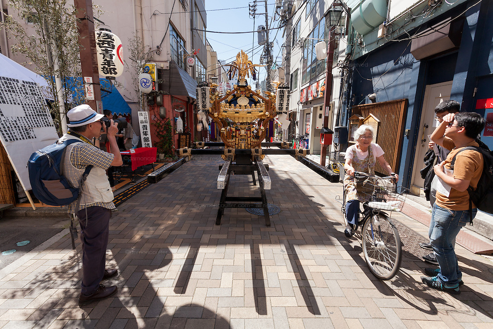 Mikoshi in the street before the start of the Sanja matsuri in Asakusa, Tokyo, Japan. Friday May 13th 2016. The Sanja matsuri is one of the biggest festivals in Japan. Taking place over the 3 days of the second weekend of May (May 13th to 15th) it features many mikoshi, or portable shrines, that are carried around by local groups to bring blessings and prosperity to their neighbourhoods