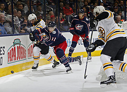 October 30, 2017 - Columbus, OH, USA - Columbus Blue Jackets left wing Matt Calvert (11) and Boston Bruins defenseman Kevan Miller (86) battle for the puck along the boards during the 1st period of their NHL game at Nationwide Arena in Columbus, Ohio on Oct. 30, 2017. (Credit Image: © Kyle Robertson/TNS via ZUMA Wire)