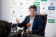Swansea City Manager Michael Laudrup speaking at the Barclays Premier league pre match press conference at the Liberty Stadium in Swansea pic by Phil Rees/ Andrew Orchard sports photography.