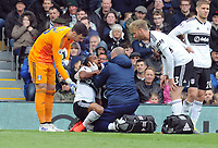 Football - 2018 / 2019 Premier League - Fulham vs. Cardiff City<br /> <br /> Denis Odoi of Fulham receives attention for a blow to the head as was subsequently substituted, at Craven Cottage.<br /> <br /> COLORSPORT/ANDREW COWIE