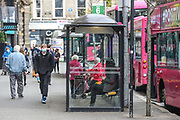 People some of them wearing face protective masks are seen waiting for the bus outside a bus station in Belfast on Sunday, April 25, 2021. (Photo/ Vudi Xhymshiti)