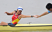 Shunyi, CHINA.  Start of a heat of the women's eights,  ROU W8+,  cox,  Elena GEORGESCU passing tissue back to the boat holder on the start pontoon. 2008 Olympic Regatta, Shunyi Rowing Course. Monday. 11.2008  [Mandatory Credit: Peter SPURRIER, Intersport Images]