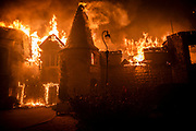 The Chateau Boswell winery goes up in flames as the Glass Fire burns along the Silverado Trail near St. Helena in the Napa Valley on Sunday night, Sept. 27, 2020.