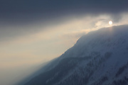 The sun begins to set on a cloudy day at Le Tour, near Chamonix in the French Alps