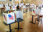02 JUNE 2020 - WEST DES MOINES, IOWA: People vote in socially distanced voting booths on primary election day at Valley High School in West Des Moines. Because of the Coronavirus pandemic, all of the polling places in West Des Moines were consolidated to Valley High School, where voting booths were set up with social distancing in mind and booths were sanitized before they were reused. Although Iowa uses a caucus system to select presidential candidates, they use a primary election to select candidates for other offices. Statewide, the most watched race Tuesday is the Democratic Senate primary to select a candidate to run against Republican incumbent Joni Ernst.        PHOTO BY JACK KURTZ
