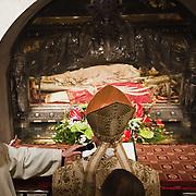 MILAN, ITALY - DECEMBER 07:  Cardinal Dionigi Tettamanzi, Archibishop of Milan, prays in front of the relics of Saint Ambrogio on December 7, 2010 in Milan, Italy. The skeleton of Saint Ambrogio lays with the remains of San Gervasio e San Protasio in the ancient basilica of Sant'Ambrogio in the city centre of Milan
