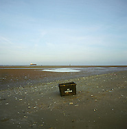 A box used for recycling sitting washed up on the beach at Crosby, Merseyside at the mouth of the river Mersey. The Mersey is a river in north west England which stretches for 70 miles (112 km) from Stockport, Greater Manchester, ending at Liverpool Bay, Merseyside. For centuries, it formed part of the ancient county divide between Lancashire and Cheshire.