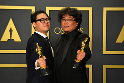 February 9, 2020, Los Angeles, California, USA: BONG JOON-HO AND HAN JIN-WON in the Press Room during the 92nd Academy Awards, presented by the Academy of Motion Picture Arts and Sciences (AMPAS), at the Dolby Theatre in Hollywood. (Credit Image: © Kevin Sullivan via ZUMA Wire)