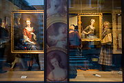 Art lovers are seen through a window while attending a private exhibition preview of a series at Phillip Mould, a dealer of paintings in London. Philip Mould & Company are a leading specialist dealer in British art and Old Masters. Our gallery is located in Dover Street at the centre of London's art market. They have a large selection of fine paintings for sale, from Tudor and Jacobean panel pictures to eighteenth century landscapes, as well as works by Old Masters such as Titian and Van Dyck, and antique portrait miniatures.
