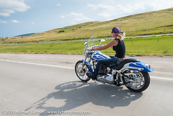 Riding I-90 during the Sturgis Black Hills Motorcycle Rally. SD, USA. August 4, 2014.  Photography ©2014 Michael Lichter.
