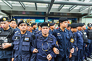 "01 JUNE 2014 - BANGKOK, THAILAND: Thai police line up to remove protestors from Terminal 21 shopping mall in Bangkok after a flash mob protested against the coup in the mall. The Thai army seized power in a coup that unseated a democratically elected government on May 22. Since then there have been sporadic protests against the coup. The protests Sunday were the largest in several days and seemed to be spontaneous ""flash mobs"" that appeared at shopping centers in Bangkok and then broke up when soldiers arrived. Protest against the coup is illegal and the junta has threatened to arrest anyone who protests the coup. There was a massive security operation in Bangkok Sunday that shut down several shopping areas to prevent the protests but protestors went to malls that had no military presence.    PHOTO BY JACK KURTZ"