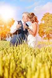 Bride and Groom celebrating in Cornfield