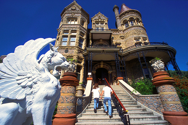 Couple walking up a staircase to to a historic building in Galveston