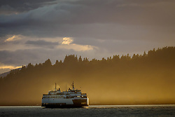 United States, Washington, Seattle, ferry in mist  off Bainbridge Island