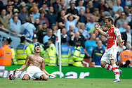 Arsenal's Alexis Sanchez (l) celebrates after scoring his teams second goal of the game.  Barclays Premier league match, Arsenal v Manchester city at the Emirates Stadium in London on Saturday 13th Sept 2014.<br /> pic by John Patrick Fletcher, Andrew Orchard sports photography.