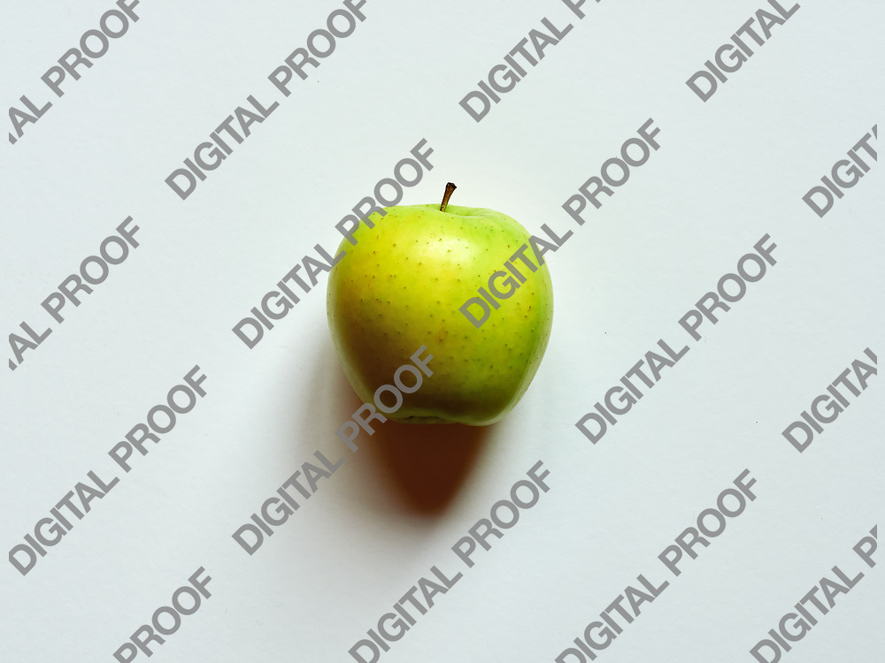 Above view of a Green apple isolated in a white background in studio