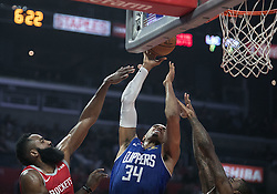 October 21, 2018 - Los Angeles, California, U.S - Tobias Harris #34 of the Los Angeles Clippers drives in between two defenders during their NBA game with the Houston Rockets on Sunday October 21, 2018 at the Staples Center in Los Angeles, California. (Credit Image: © Prensa Internacional via ZUMA Wire)
