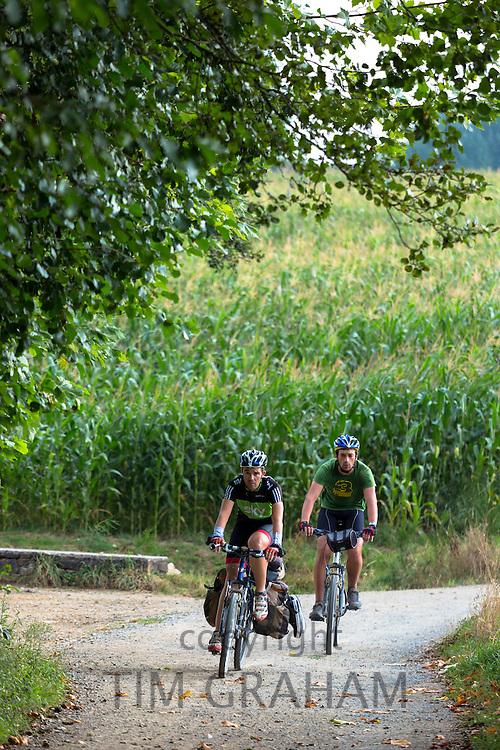 Cyclists on the Camino de Santiago Pilgrim's route to Santiago de Compostela in Galicia, Spain