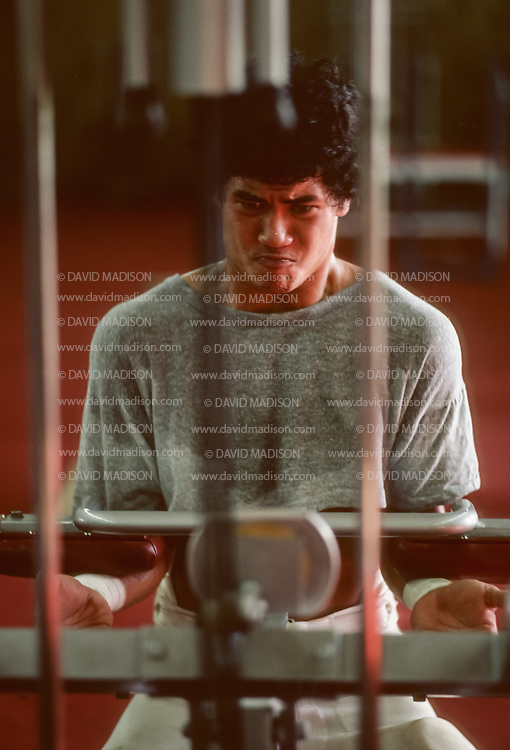 COLLEGE FOOTBALL:  A Stanford football player works out in the weight room, September 1981, Stanford University, Palo Alto, California.  Photograph by David Madison | www.davidmadison.com.