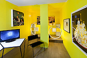 Relative Space flooring, Faktura Peak desk, James Weingrod video installation 'Let me tell you a secret...', Christopher Twins 'Crystal Seven', Farrah Sit Noir Chair, Ghiora Aharoni Design Studio Eclipse Lights, William Lee 'Checker' bookshelves, Christopher Twins 'Crystal Three' and 'Road to Hollow Earth',  Erica Prince 'Planet' and 'Drawing from the Permission Granted Series'