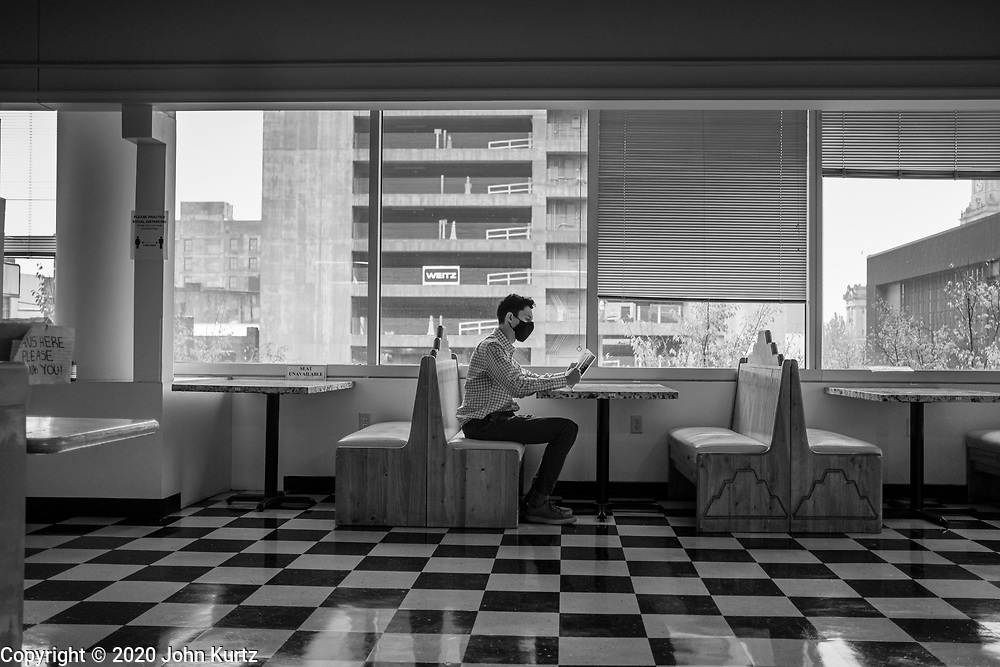 22 OCTOBER 2020 - DES MOINES, IOWA: A customer waits for his lunch in a restaurant in downtown Des Moines. Business in the restaurant, has dropped by more than 50 percent because of the Corornavirus pandemic. PHOTO BY JACK KURTZ