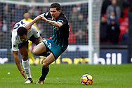 Pierre-Emile Hojbjerg of Southampton (R) battles with Mousa Dembele of Tottenham Hotspur (L). Premier league match, Tottenham Hotspur v Southampton at Wembley Stadium in London on Boxing Day Tuesday 26th December 2017.<br /> pic by Steffan Bowen, Andrew Orchard sports photography.