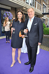 JACK & PATTY MASRI at a party to celebrate the launch of Bentley's The Collection held at 6 Square Rigger Row, Plantation Wharf, York Road, London SW11 on 25th June 2012.