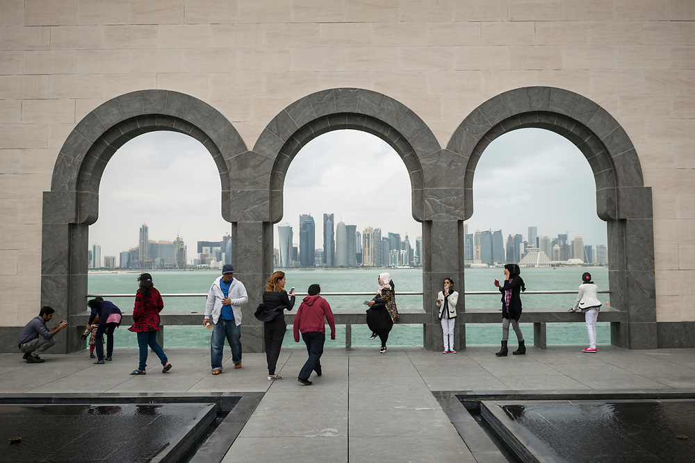 People enjoy the view of the modern Doha skyline from outside the Islamic Musueum of Art in Doha, Qatar.