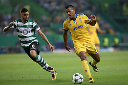 October 31, 2017 - Lisbon, Portugal - Juventus' Brazilian defender Alex Sandro vies with Sporting's midfielder Bruno Fernandes from Portugal (L)  during the UEFA Champions League football match Sporting CP vs Juventus at the Alvalade stadium in Lisbon, Portugal on October 31, 2017. (Credit Image: © Pedro Fiuza/NurPhoto via ZUMA Press)