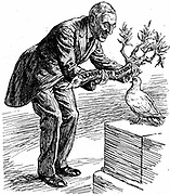 US President Wilson giving the Dove of Peace an olive branch labelled 'League of Nations'.  The Dove says 'Of course I want  to please everybody; but isn't this a bit thick?' Cartoon from 'Punch', London, 26 March 1919.