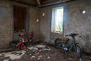 Old abandoned motorcycle in a derelict house in Kioni, Ithaca, Greece. Ithaca, Ithaki or Ithaka is a Greek island located in the Ionian Sea to the west of continental Greece. Ithacas main island has an area of 96 square kilometres. It is the second-smallest of seven main Ionian Islands.