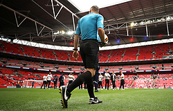 Referee Paul Tierney inspects the pitch in the view of the Derby County players before the game