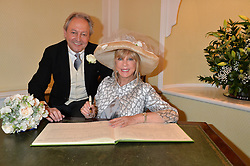 PATTIE BOYD and ROD WESTON photographed at their wedding at Chelsea Registry Office, Chelsea Old Town Hall, King's Road, London on 30th April 2015. Pattie Boyd was previously married to both George Harrison and Eric Clapton.