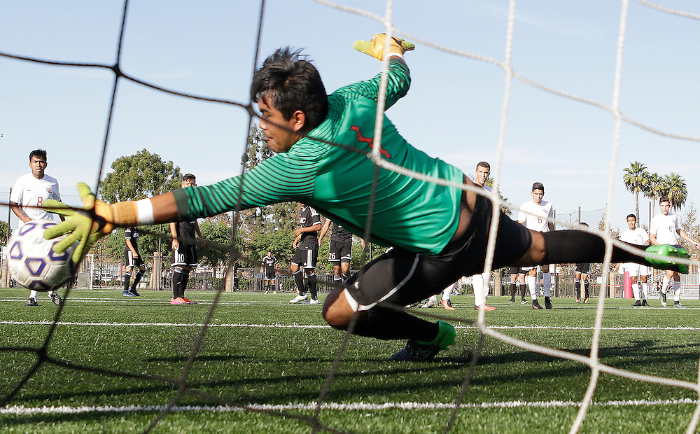 Katja Liebing/Sports Shooter Academy<br /> Orange Coast College's Osiel Porcayo dives for the ball in a conference game against Santa Ana at Santa Ana College on Friday, Nov. 4, 2016. Santa Ana won the game 3-0.