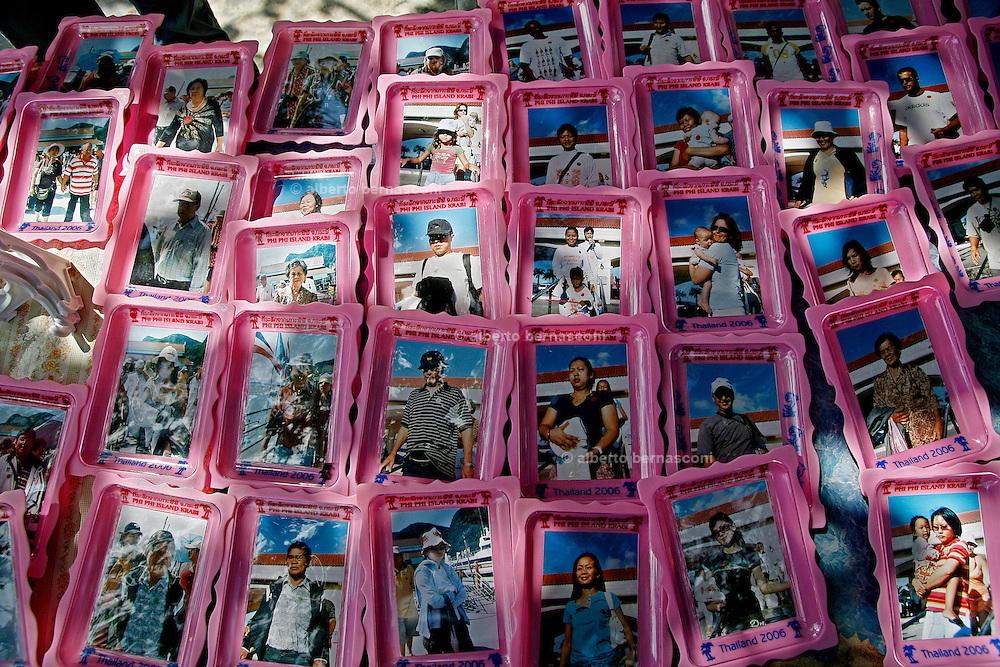 Thailandia , Phi Phi Island, ashtray with tourists photos
